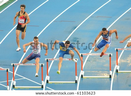 BARCELONA, SPAIN - JULY 29: Competitors of 400m Hurdles Men during the 20th European Athletics Championships at the Olympic Stadium on July 29, 2010 in Barcelona, Spain - stock photo