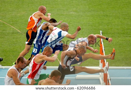 BARCELONA, SPAIN - JULY 30: Competitors of 100m Hurdles Men during the 20th European Athletics Championships at the Olympic Stadium on July 30, 2010 in Barcelona, Spain - stock photo