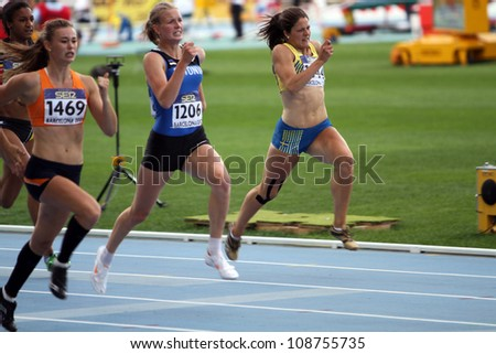 BARCELONA, SPAIN - JULY 13: Girls on the 200 meters race of the Heptathlon event on the IAAF World Junior Championships on July 13, 2012 in Barcelona, Spain. - stock photo