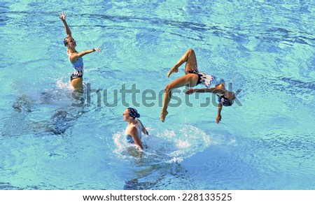 BARCELONA, SPAIN-JULY 15, 2003: Italy swimming synchronized team in action during the World Swimming Championship, in Barcelona. - stock photo