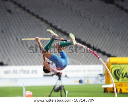 BARCELONA, SPAIN - JULY 12: Ivan Horvat from Croatia the winner of the silver medal in pole vault competition on IAAF World Junior Athletics Championships on July 12, 2012 in Barcelona, Spain. - stock photo