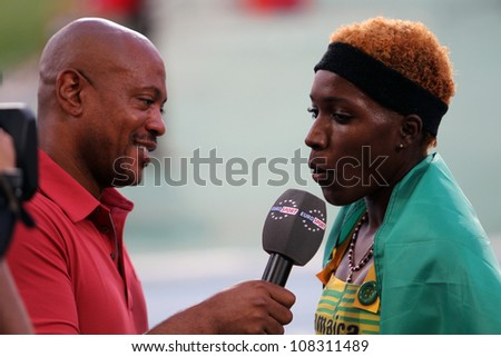 BARCELONA, SPAIN - JULY 14: Janieve Russell from Jamaica the winner of 400 meters hurdles gives interview to eurosport on IAAF World Junior Athletics Championships on July 14, 2012 in Barcelona, Spain - stock photo