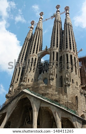 BARCELONA, SPAIN - JULY  29: La Sagrada Familia - the impressive cathedral designed by Gaudi, which is being build since 19 March 1882 and is not finished yet July 29, 2010 in Barcelona, Spain.  - stock photo