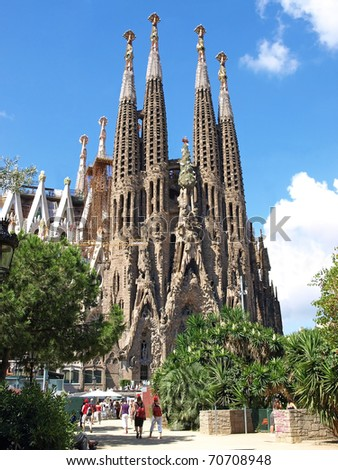 BARCELONA, SPAIN - JULY 19: La Sagrada Familia - the impressive cathedral designed by Gaudi, which is being build since 19 March 1882 and is not finished yet July 19, 2009 in Barcelona, Spain. - stock photo