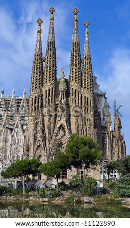 BARCELONA, SPAIN - JULY 16: La Sagrada Familia - the impressive cathedral designed by Gaudi, which is being build since 19 March 1882 and is not finished yet July 16, 2011 in Barcelona, Spain. - stock photo