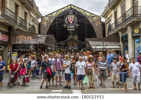 BARCELONA, SPAIN - JULY 21: Main gate at La Boqueria market in July 21, 2012 in Barcelona, Spain. Market has been known since 1217. Now - one of the city's foremost tourist landmarks  - stock photo
