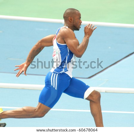 BARCELONA, SPAIN - JULY 29: Martial Mbandjock of France competes on the Men 200m during the 20th European Athletics Championships at the Olympic Stadium on July 29, 2010 in Barcelona, Spain - stock photo