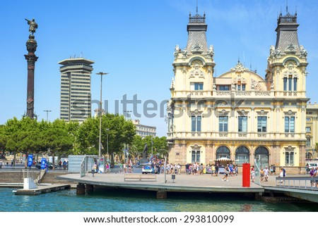 BARCELONA, SPAIN - JULY 4: Port Vell and Columbus Monument on July 4, 2015 in Barcelona, Spain. It is a 60 meters tall monument for Christopher Columbus at the lower end of La Rambla - stock photo
