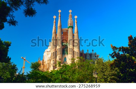 BARCELONA, SPAIN - JULY 31, 2012: Sagrada Familia - the impressive cathedral designed by Antonio Gaudi, which is being build since 19 March 1882 and is not finished yet. - stock photo