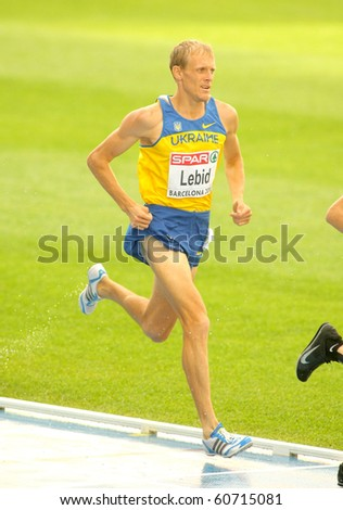 BARCELONA, SPAIN - JULY 29: Serhiy Lebid of Ukraine competes on the Men 5000m during the 20th European Athletics Championships at the Olympic Stadium on July 29, 2010 in Barcelona, Spain - stock photo