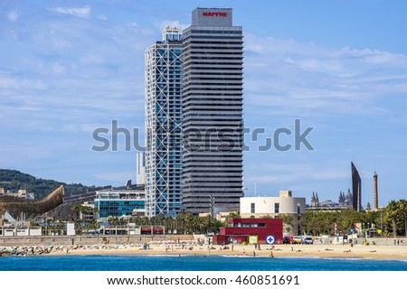 BARCELONA, SPAIN - JULY 13, 2016: Skyscraper Torre Mapfre in the Olympic Port. It is named after its owner, Mapfre, an insurance company.