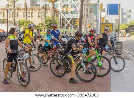 BARCELONA, SPAIN - JULY 6, 2015: Team cycling enthusiasts on the streets of Barcelona.