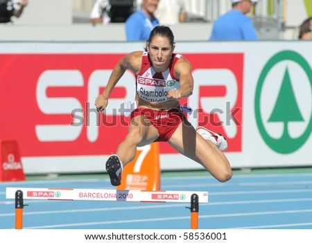 BARCELONA, SPAIN - JULY 27: Vania Stambolova of Bulgaria competes in the Women 400m Hurdles during the 20th European Athletics Championships at the Olympic Stadium on July 27, 2010 in Barcelona, Spain. - stock photo