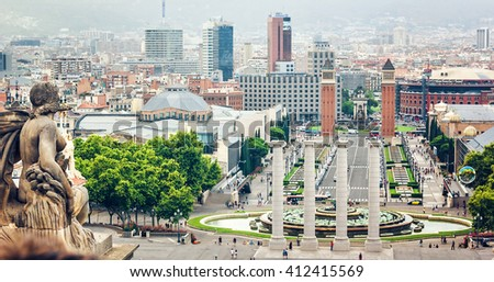 BARCELONA, SPAIN - JULY 28: View from Montjuic to Plaza de Espana (Plaza d'Espanya) including the four columns and the Venetian towers in Barcelona, Spain. July 28, 2015 in Barcelona, Spain.