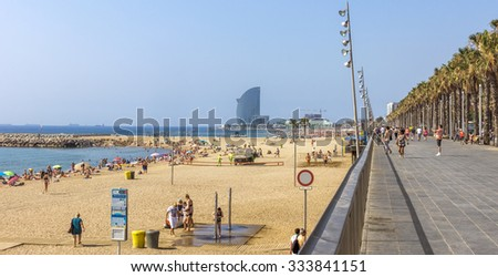 BARCELONA, SPAIN - JULY 12, 2015: View of Barceloneta Beach from Promenade. Barceloneta Beach - one of the most popular in the city.