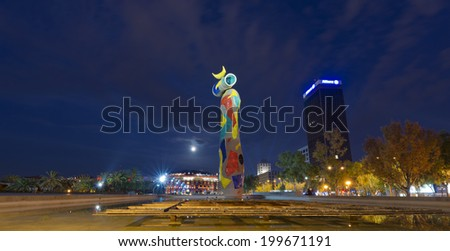 BARCELONA, SPAIN - JUN 12, 2014: Dona i Ocell (Woman and Bird) of Joan Miro (1893-1983) realized by Joan Gardy Artigas (1983) at night in the Park Joan Miro. In the background the Bullring Arenas - stock photo