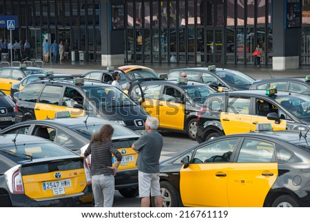 BARCELONA, SPAIN - JUNE 18: A lot of taxi cars are waiting passengers near entrance of main railway station Barcelona Sants on June 18, 2014, Barcelona, Catalonia, Spain. - stock photo