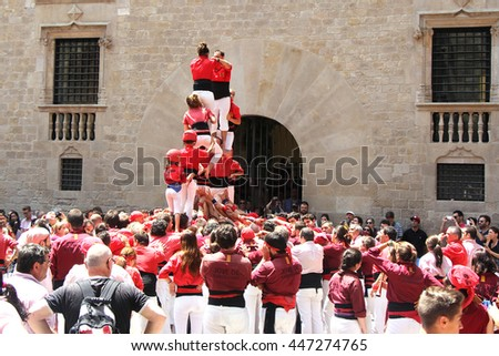 BARCELONA, SPAIN - JUNE 26, 2016: Castellers group of people that build human castles on June 26, 2016 in Barcelona.  Castles is a Human Tower traditional festivities in Catalonia Spain. - stock photo