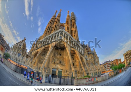 BARCELONA, SPAIN, JUNE 15: Colorful HDR image of the back side of the famous Sagrada Familia. the cathedral designed by Gaudi, which is being build since 1882 and is not finished yet June, 15, 2016 - stock photo