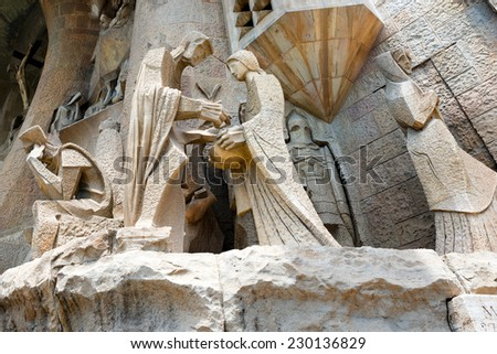 BARCELONA, SPAIN - JUNE 12, 2014: Details of the facade of the famous Catholic basilica of the Sagrada Familia in Barcelona, Catalonia, Spain. Designed by Antoni Gaudi. Start of construction, 1882