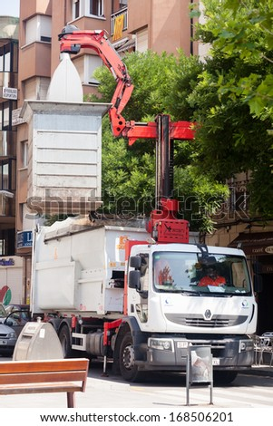 BARCELONA, SPAIN - JUNE 23: Garbage truck collects garbage dumpster in June 23, 2013 in Barcelona, Spain - stock photo