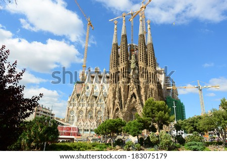 BARCELONA, SPAIN - June 10: Nativity Facade of Sagrada Familia designed by Antonio Gaudi on June 10, 2013 in Barcelona, Spain. - stock photo