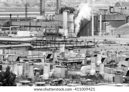 Barcelona, Spain - June 4, 2015: Petrochemical factory in outskirt of Barcelona.  - stock photo