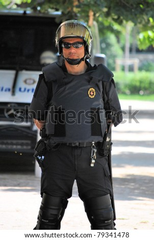 BARCELONA, SPAIN-JUNE 14, Policeman protects Parliament of Catalonia, June 14, 2011 in Barcelona, Spain Demonstration against the program of reduction of  budget on social needs - stock photo
