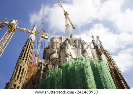 BARCELONA, SPAIN - JUNE 30, 2013: The Basilica of La Sagrada Familia against blue sky. Designed by Antoni Gaudi - stock photo