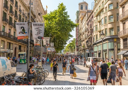 BARCELONA, SPAIN - JUNE 30. Tourists and residents of Barcelona in the pedestrian zone the street 'Portal del Angel' which leads to the heart of the city, the Placa de Catalunya. Barcelona on 30, 2015 - stock photo