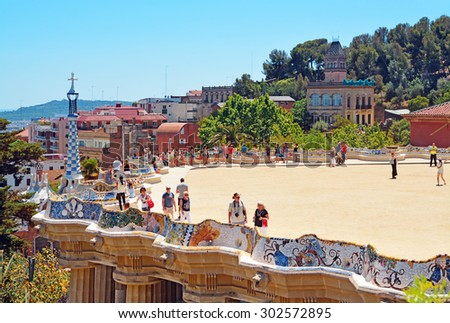 BARCELONA, SPAIN - JUNE 4, 2015: View of the famous bench - serpentine seating on the main terrace of Park Guell, architectural landmark designed by the famous architect Antonio Gaudi.