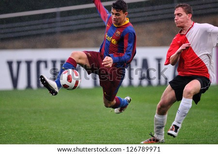 BARCELONA, SPAIN - MAR 12: Sandro Ramirez plays with F.C Barcelona youth team against L'Hospitalet on March 12, 2011 in Barcelona, Spain.