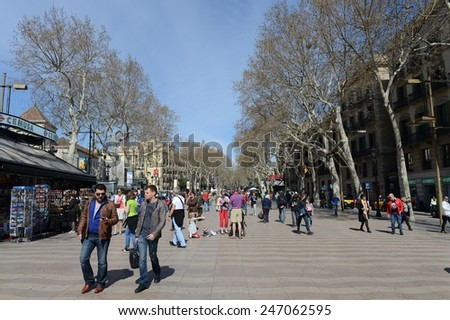BARCELONA,SPAIN -  MARCH 25, 2013: Barcelona - the capital of the Autonomous region of Catalonia and of the province. La Rambla one of symbol of city. Center of touristic life.