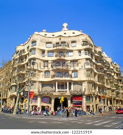 BARCELONA, SPAIN - MARCH 14: Casa Mila, or La Pedrera, on March 14, 2007 in Barcelona, Spain. This famous building was designed by Antoni Gaudi. UNESCO World Heritage Site - stock photo