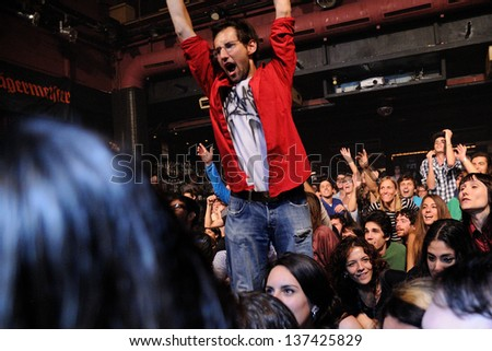 """BARCELONA, SPAIN - MARCH 13: Fans of Simple Plan band at Razzmatazz on March 13, 2012 in Barcelona, Spain. The band is currently on their """"Get Your Heart On!"""" tour. - stock photo"""
