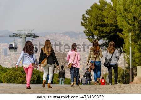 BARCELONA, SPAIN - MARCH 04, 2012: Group of young females walking down from the summit at Montjuic in Barcelona, Spain.