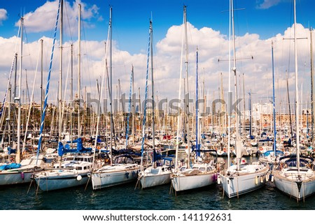 BARCELONA, SPAIN - MARCH 28: Many yachts lying at Port Vell. Barcelona, Spain in March 28, 2013 in Barcelona, Spain.  This port - one of the three ports of Barcelona - stock photo