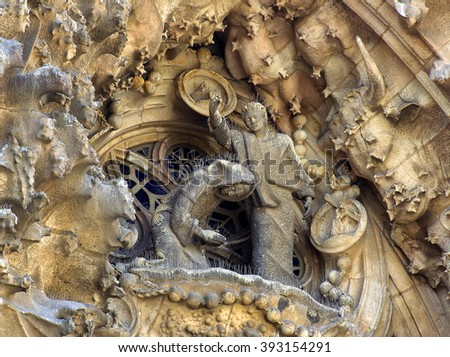 BARCELONA, SPAIN - MARCH 14, 2007: Sagrada Familia, detail of the facade. The cathedral designed by Antoni Gaudi is being built since 1882 and is not finished yet. UNESCO World Heritage Site - stock photo