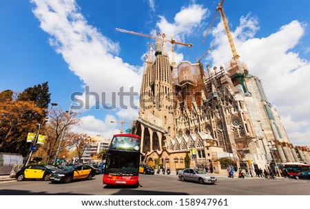 BARCELONA, SPAIN - MARCH 28: Sagrada Familia in March 28, 2013 in Barcelona, Spain. Famous Church by Catalan architect Gaudi, building is begun in 1882 and completion is planned in 2030 - stock photo