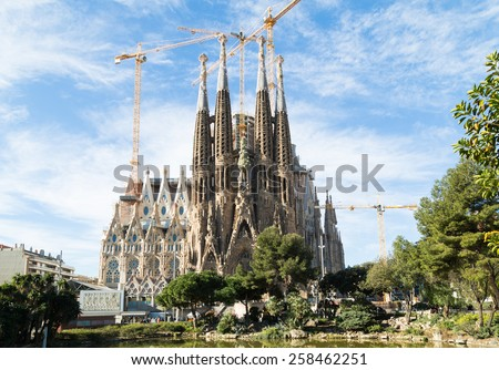 BARCELONA, SPAIN -MARCH 06: Sagrada Familia on MARCH 06, 2015: La Sagrada Familia - the impressive cathedral designed by architect Gaudi, which is being build since March 19, 1882 and is not finished. - stock photo
