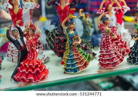 Barcelona, Spain - March 03, 2016: Statues of flamenco dancers. Very popular dolls on shop exhibition.