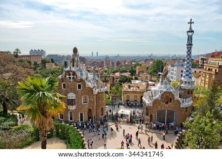 BARCELONA, SPAIN - MAY 01: Architecture in the Parc Guell, Barcelona, Spain, showing the pavilion house and spire at the entrance to the park and gardens designed by Antoni Gaudi. May 01, 2015