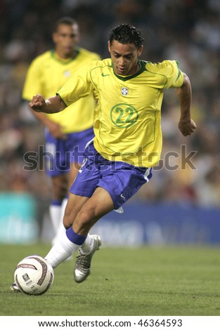 BARCELONA, SPAIN - MAY. 25: Brazilian player Ricardo Oliveira in action during the friendly match between Catalonia vs Brazil at Nou Camp Stadium on May 25, 2004 in Barcelona, Spain - stock photo