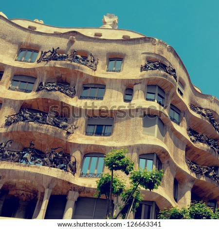 BARCELONA, SPAIN - MAY 23: Casa Mila, or La Pedrera, on May 23, 2010 in Barcelona, Spain. This famous building was designed by Antoni Gaudi - stock photo