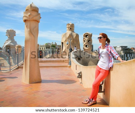 BARCELONA, SPAIN - MAY 7: Casa Mila or La Pedrera on May 7, 2013 in Barcelona, Spain. This famous building was designed by Antoni Gaudi and is one of the most visited of the city. - stock photo