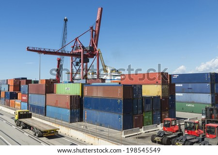 Barcelona, Spain - May 23, 2014: Container Terminal in the port of Barcelona .In the picture a truck carrying containers which is entering the terminal appears.