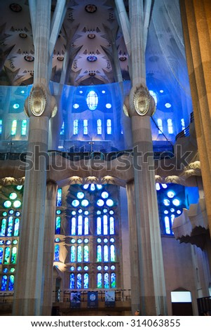 BARCELONA, SPAIN - MAY 02: Detail of Pillars and Stained Glass in Blue Light - Architectural Interior of Sagrada Familia Church, Designed by Antoni Gaudi, Barcelona, Spain. May 02, 2015. - stock photo