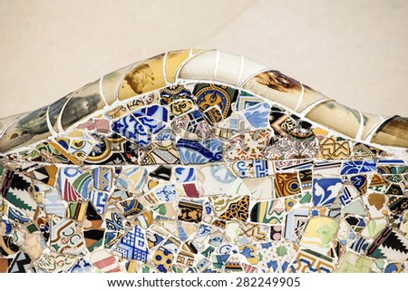 "BARCELONA, SPAIN - MAY 3, 2015: Detail of the bench in the park Guell, designed by Antonio Gaudi in Barcelona, Catalonia, Spain,  part of the UNESCO World Heritage Site ""Works of Antonio Gaudi"". - stock photo"