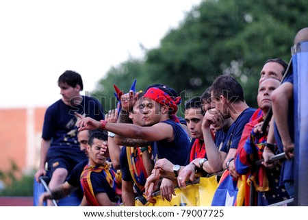 BARCELONA, SPAIN - MAY 13: F.C Barcelona players celebrates Spanish League victory with thousand of fans in the streets on May 13, 2011 in Barcelona, Spain. - stock photo