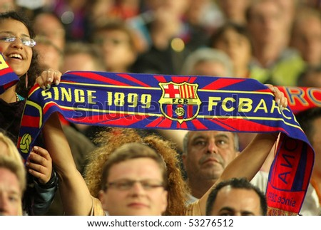 BARCELONA, SPAIN - MAY 16: FC Barcelona supporters enjoying during a Spanish League match between FC Barcelona and Valladolid at the Nou Camp Stadium on May 16, 2010 in Barcelona, Spain - stock photo